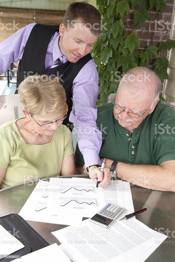 Financial Advisor Outdoors with Senior Couple stock photo