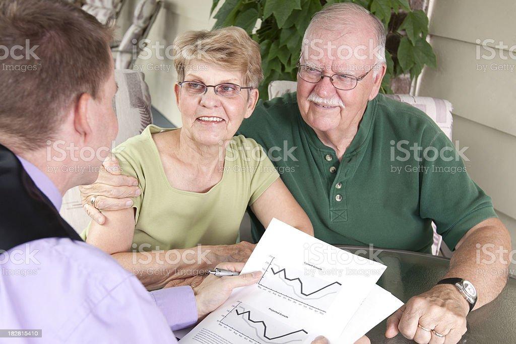 Financial Advisor Outdoors with Senior Couple royalty-free stock photo