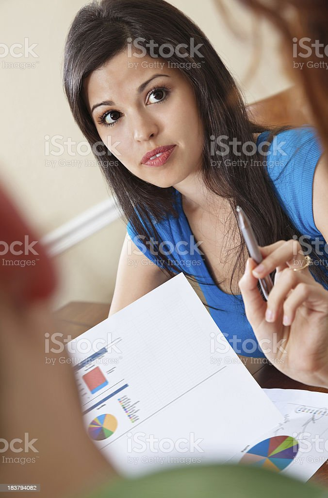Financial Advisor Pointing and Counseling Couple With Documents royalty-free stock photo