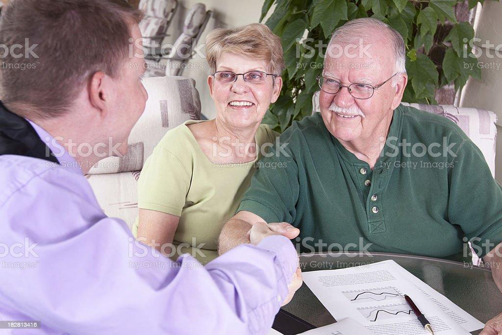 Financial Advisor Shaking Hands with Seniors royalty-free stock photo