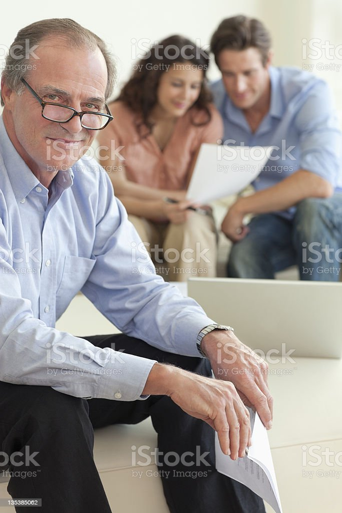 Financial advisor sitting with couple royalty-free stock photo