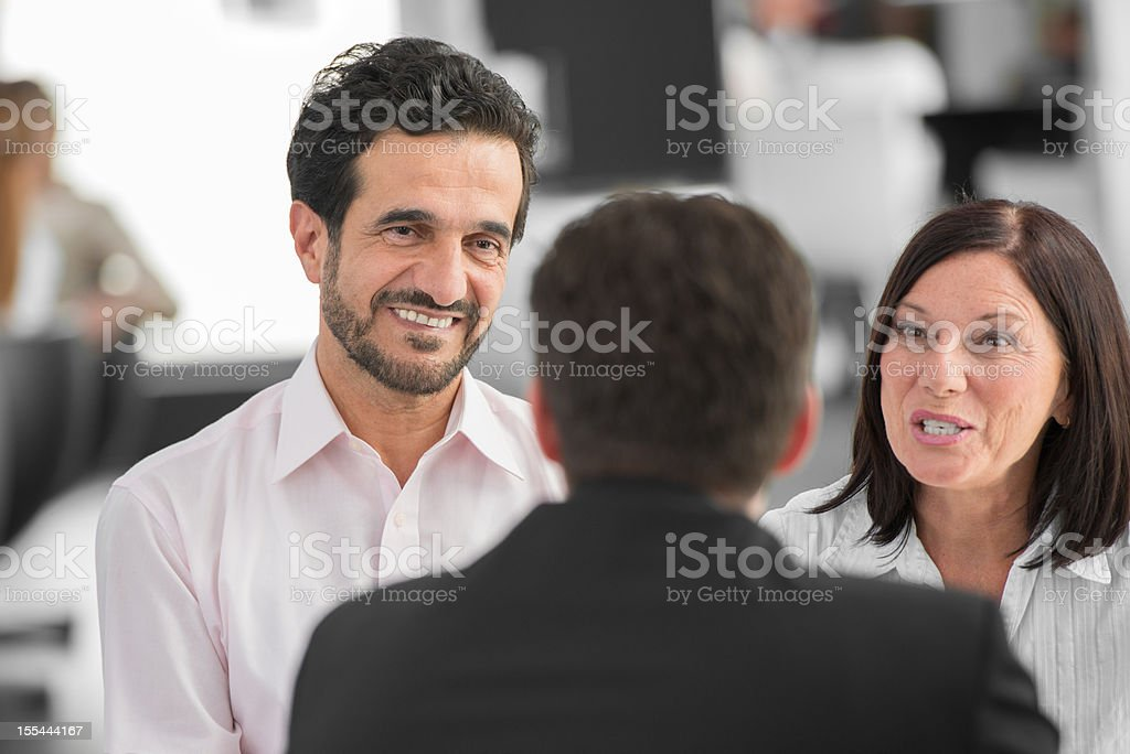 Financial Advisor Talking With His Clients royalty-free stock photo