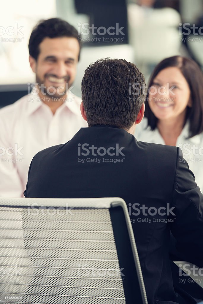 Financial Advisor Talking with Mature Couple royalty-free stock photo