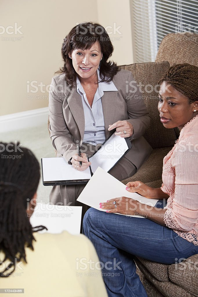 Financial advisor with African American couple stock photo