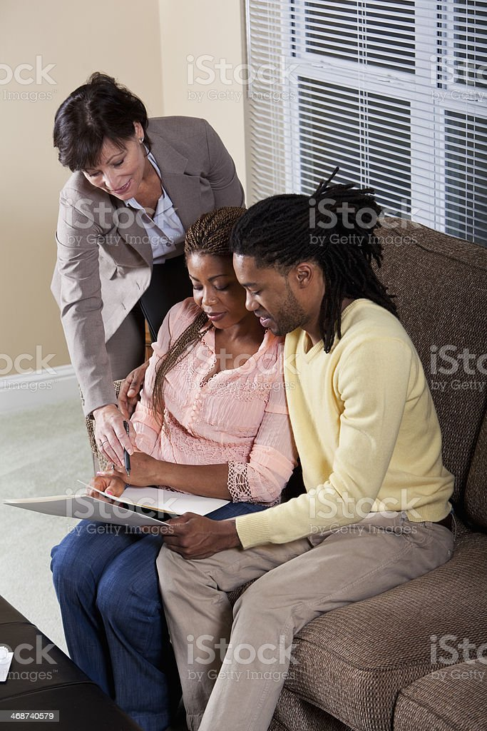 Financial advisor with African American couple royalty-free stock photo