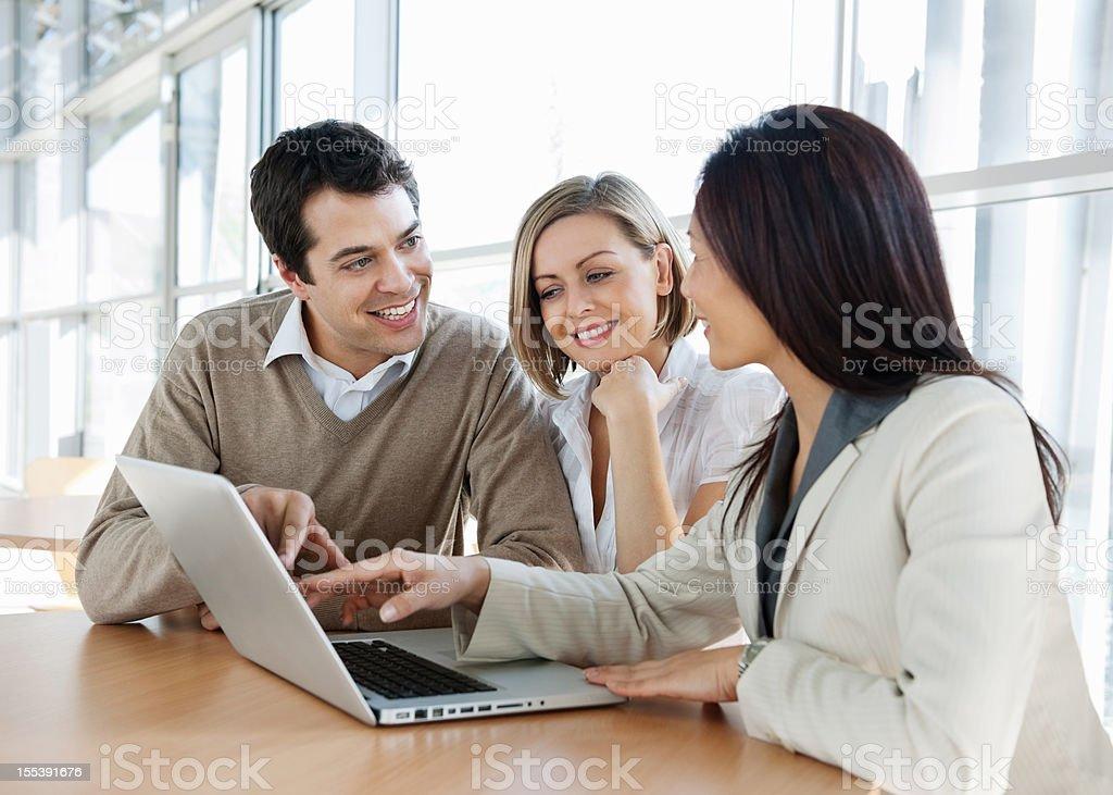 Financial Advisor With Couple royalty-free stock photo