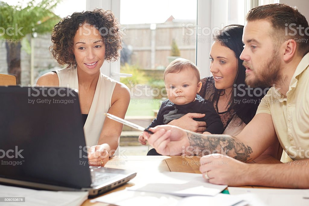 financial advisor with young family stock photo