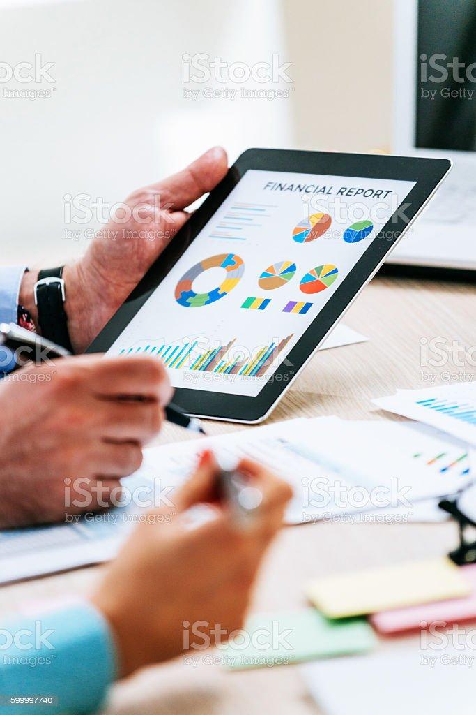 Financial advisors analyze markets stock photo