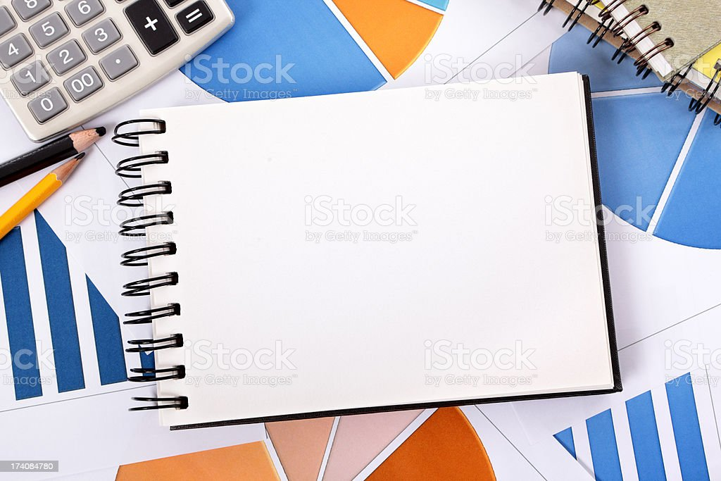 Financial background with blank notebook stock photo