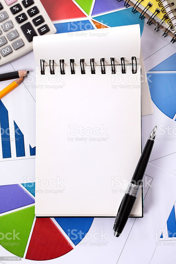 Financial background with blank notepad royalty-free stock photo