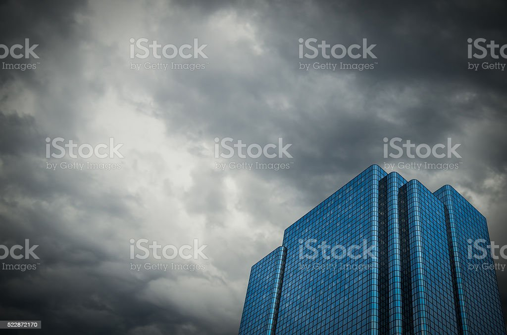 Financial Building With Stormy Sky stock photo