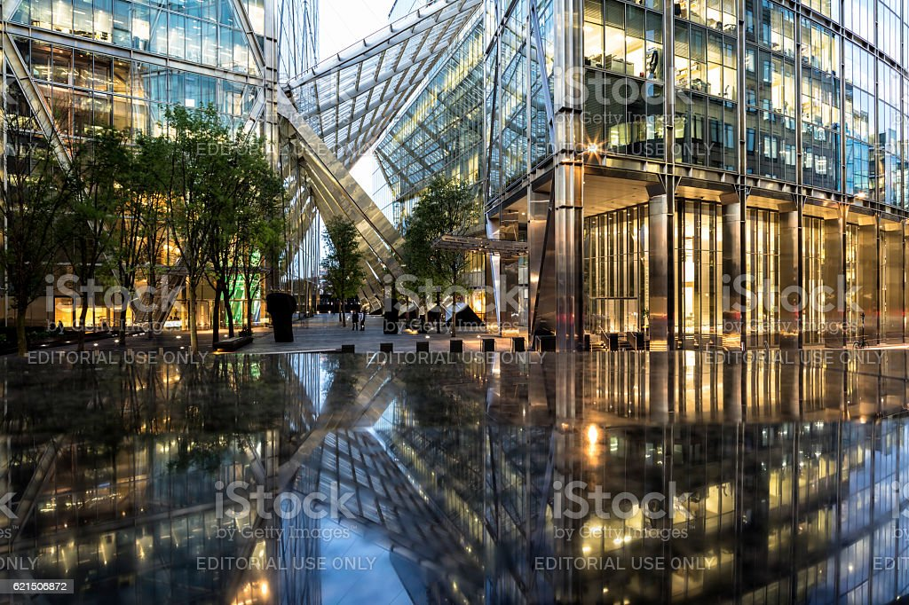 Financial buildings  and their reflection at night, London, England stock photo