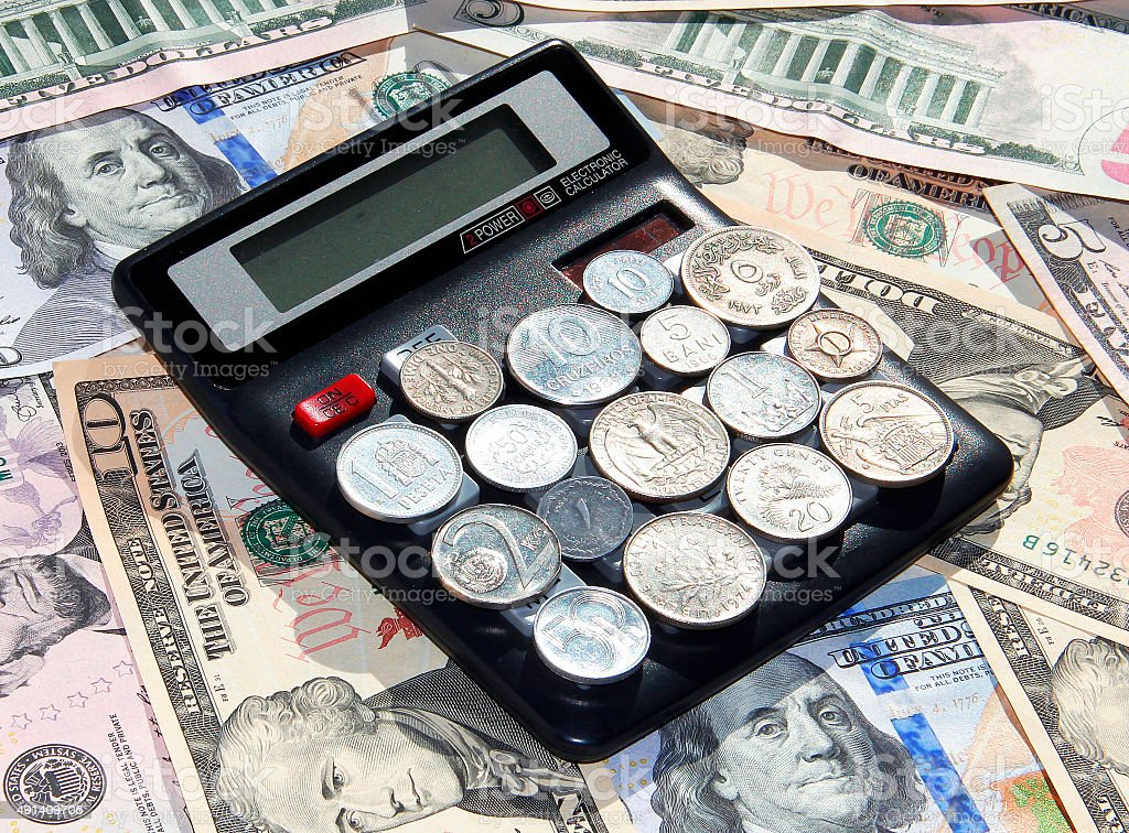 Financial calculations (calculator and money) stock photo