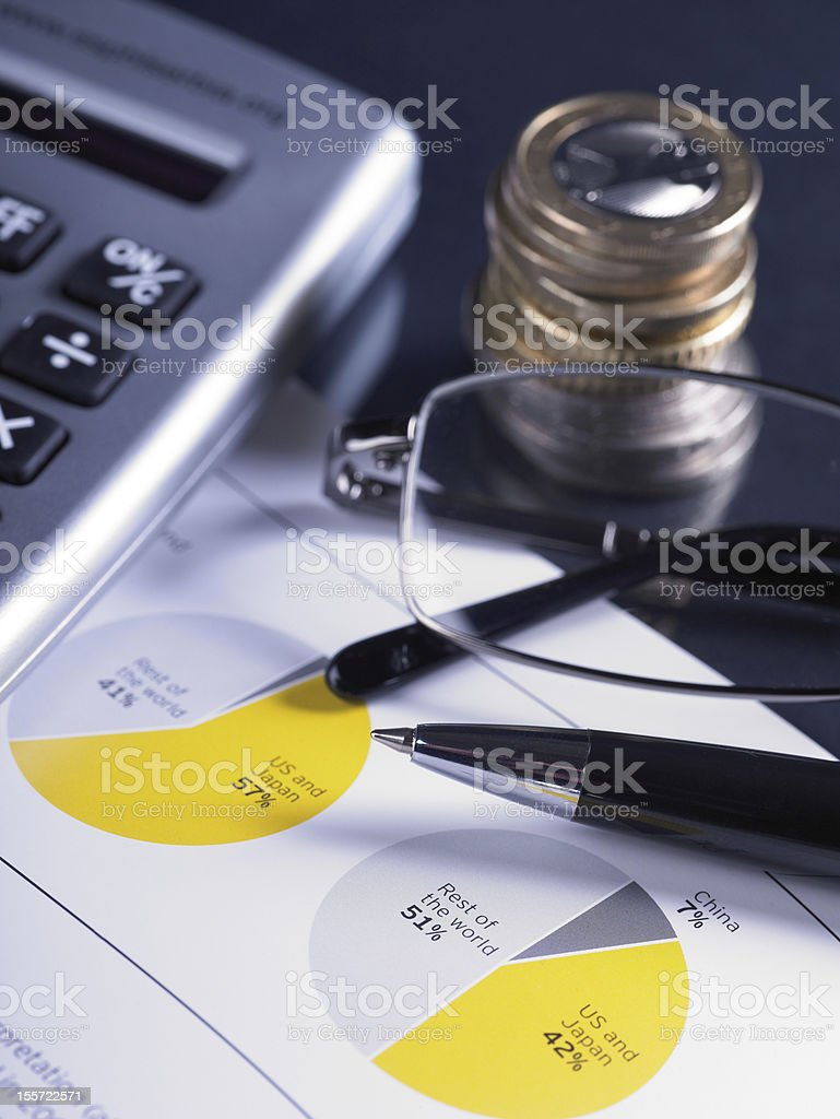 Financial Chart with Coins And Calculator royalty-free stock photo