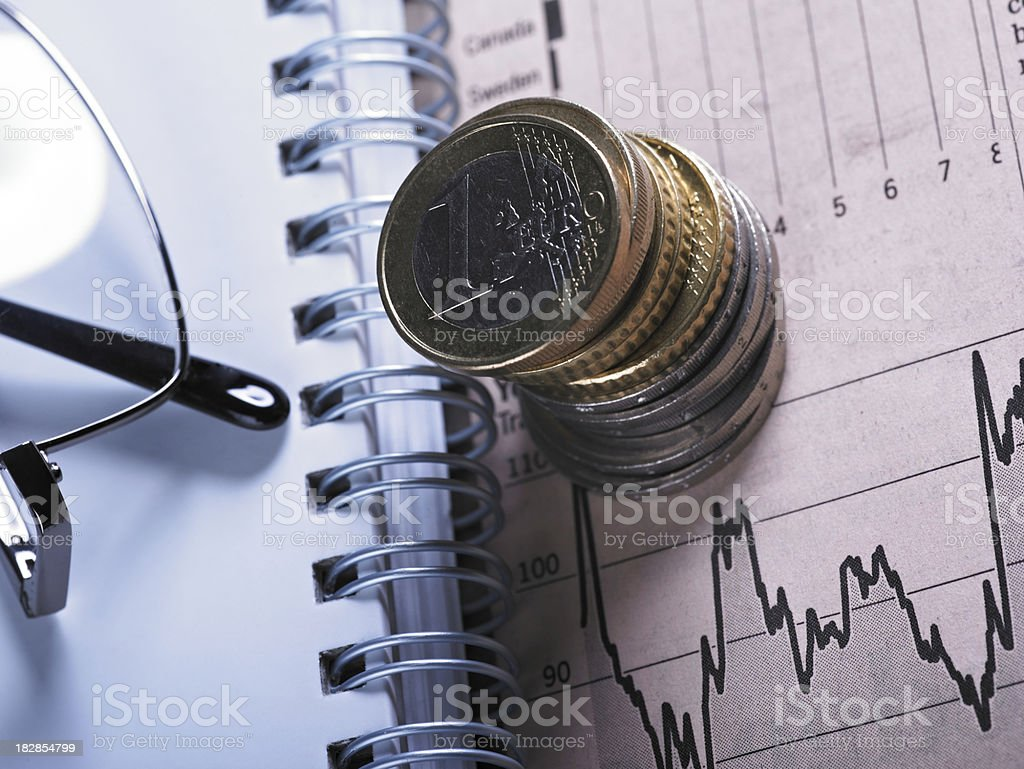 Financial Chart with Glasses And Coins royalty-free stock photo