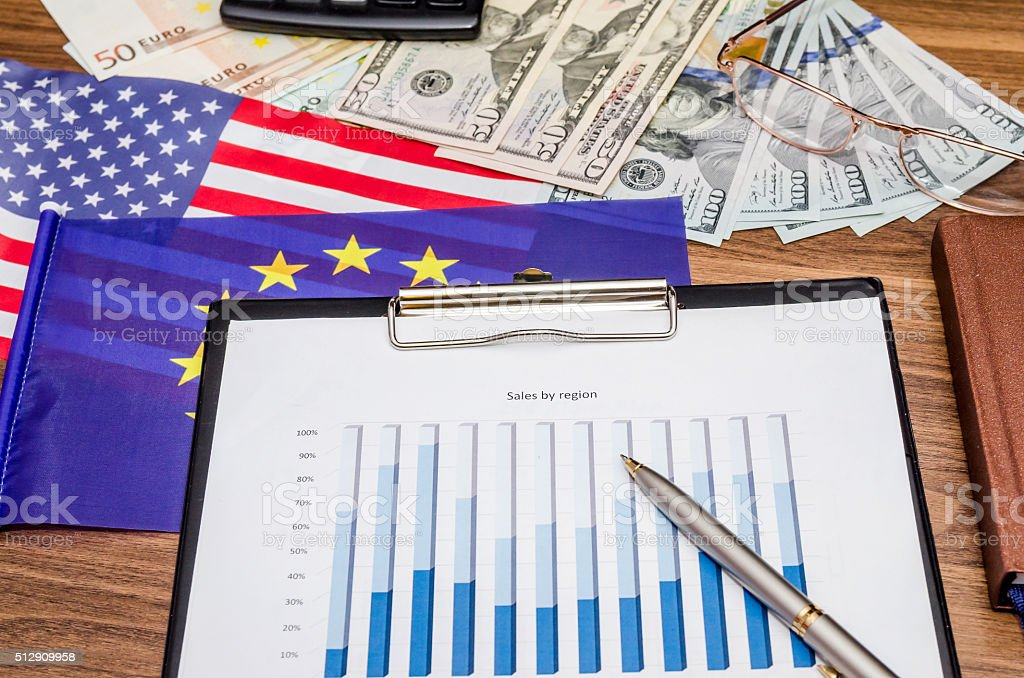 financial concept - charts of euro and US dollars stock photo
