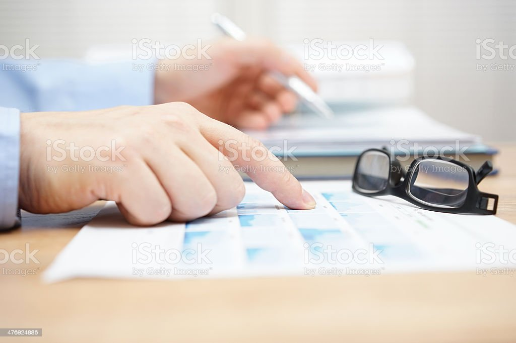 financial consultant is reviewing investment portfolio stock photo