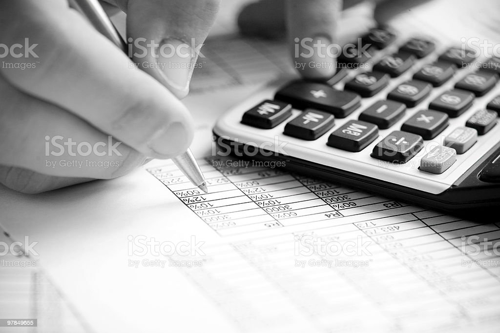 Financial data analyzing. Counting on calculator royalty-free stock photo