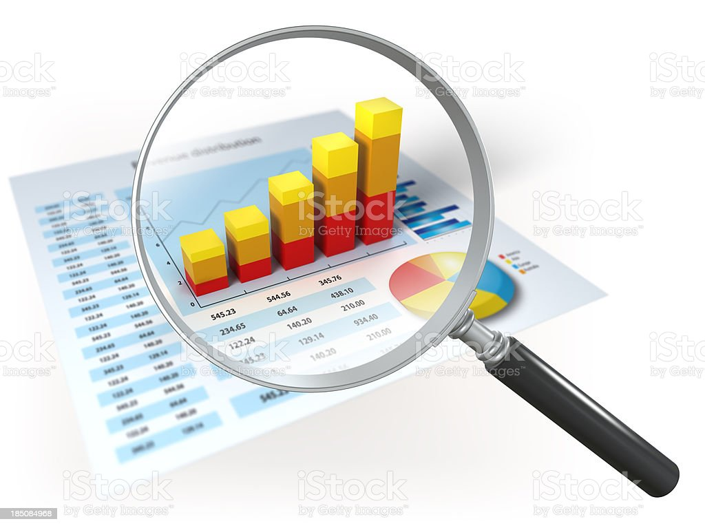 Financial data and magnifying glass, isolated on white royalty-free stock photo