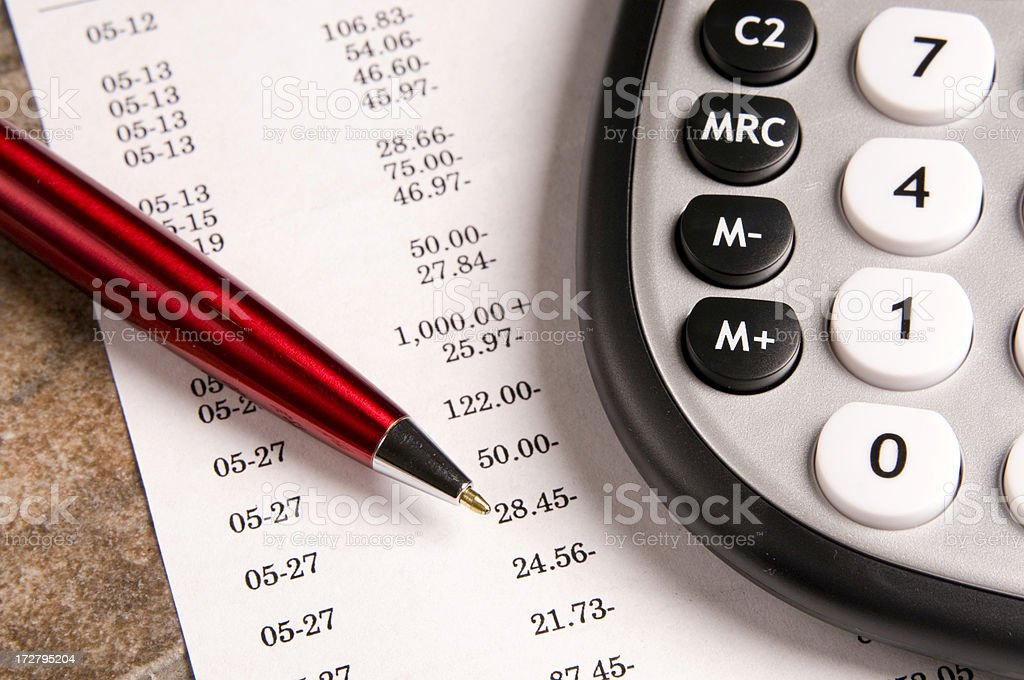 Financial data, calculator and pen royalty-free stock photo