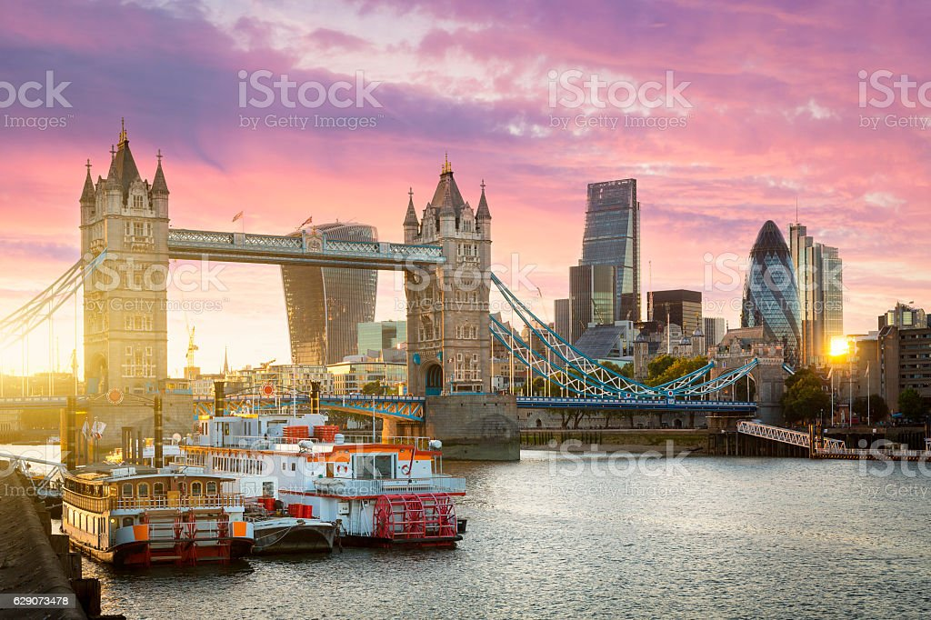 Financial District of London and the Tower Bridge at sunset stock photo