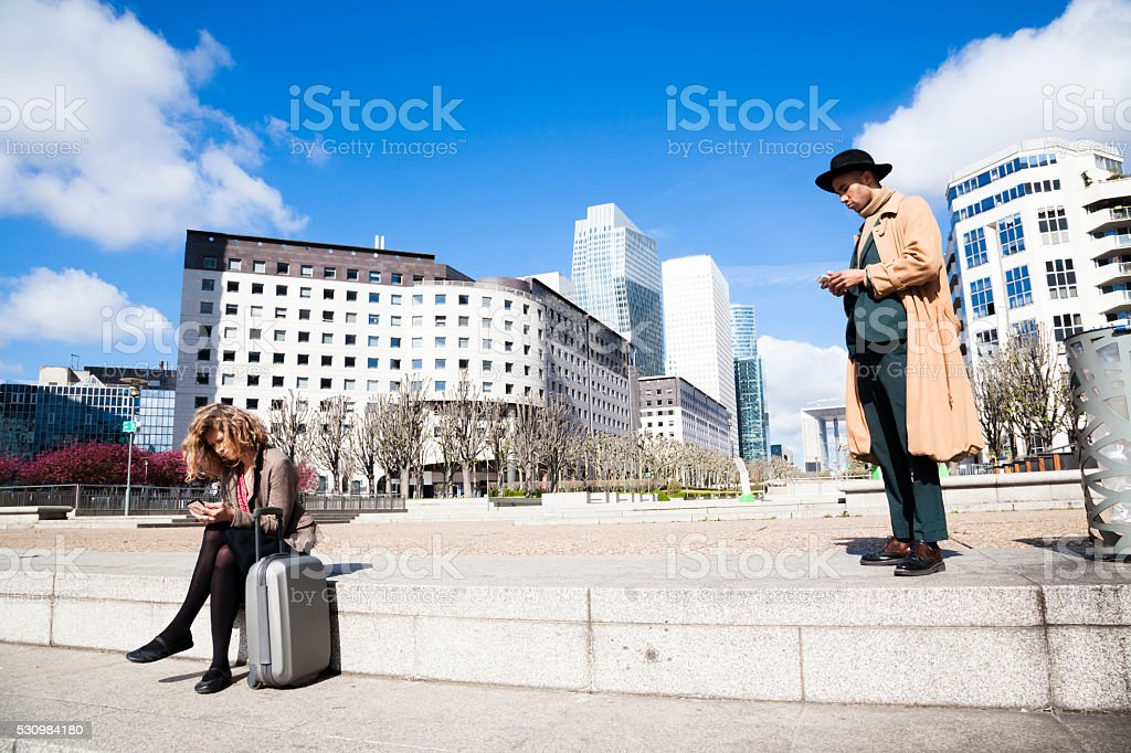 Financial district office workers on mobile phones sunny day stock photo