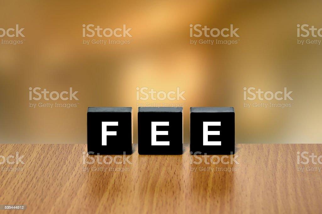 financial fee on black block stock photo