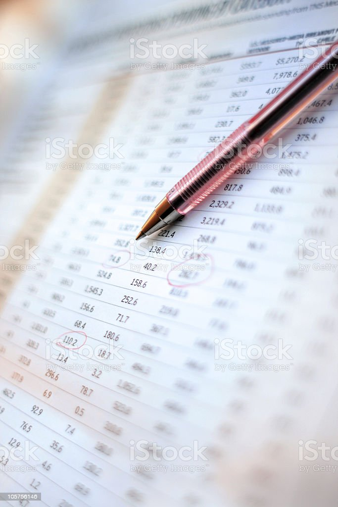 Financial Figures: Pen Placed on a Spreadsheet - Close Up royalty-free stock photo