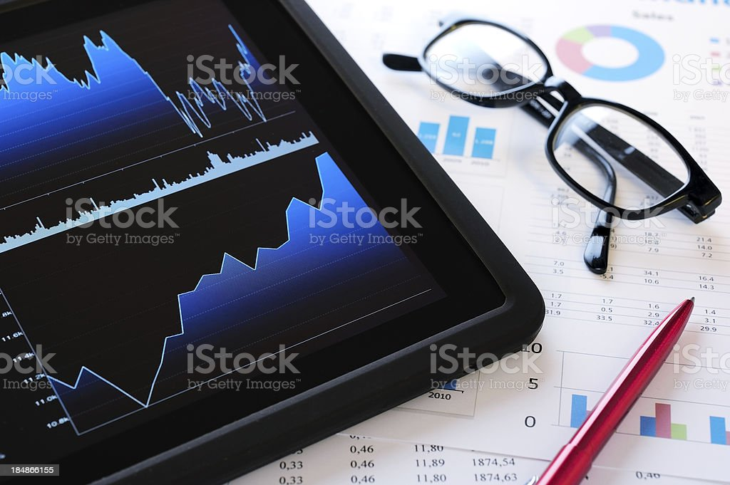 Financial figures with digital tablet royalty-free stock photo