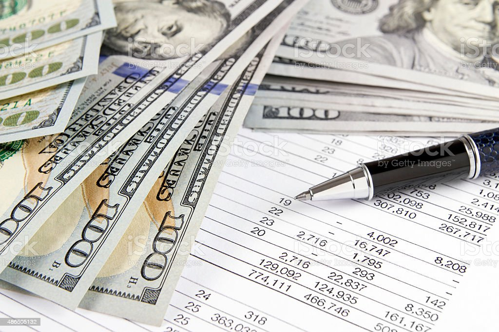 Financial Figures with Stack of Money stock photo