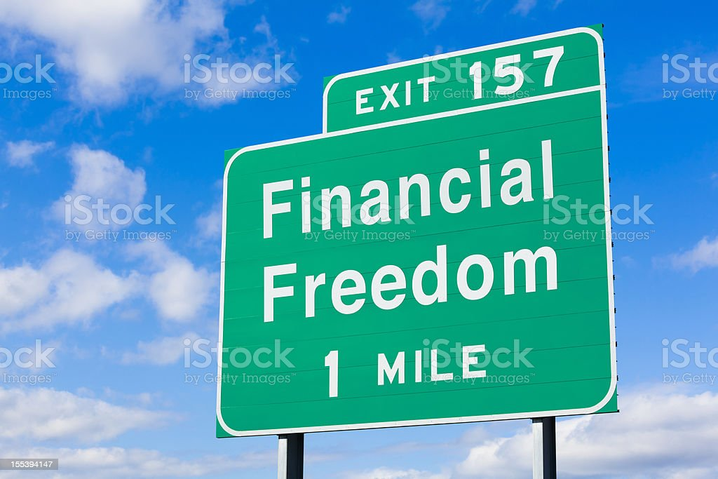 Financial Freedom One Mile Highway Sign stock photo