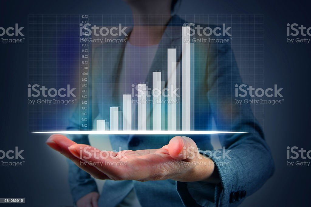 Financial graph on hand stock photo