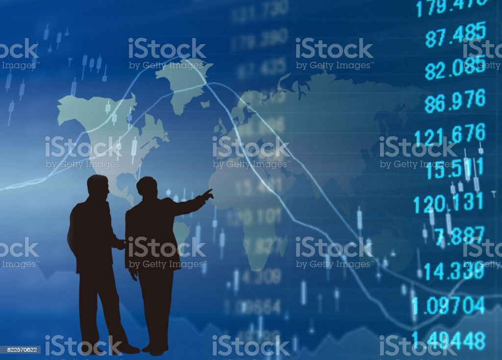 Financial graphs analysis and Businessman stock photo