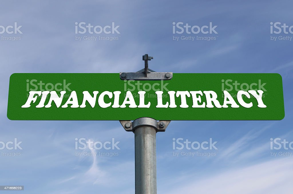 Financial literacy road sign stock photo