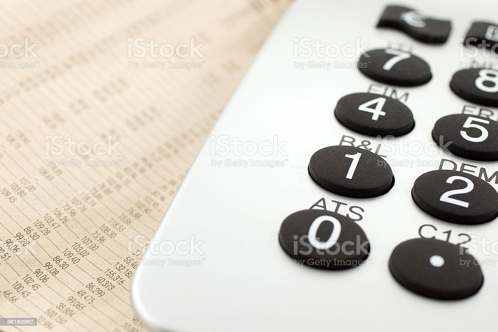 financial newspaper with calculator royalty-free stock photo