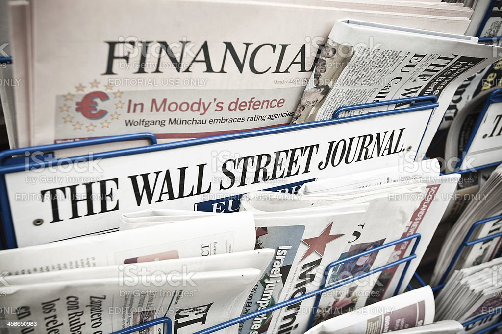 Financial Newspapers on a Newsstand stock photo