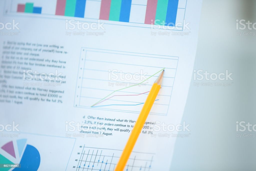 Financial paper charts and graphs on the table stock photo