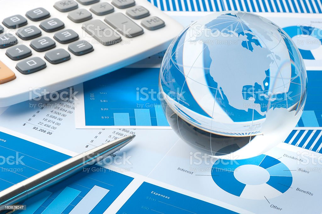 Financial papers with globe stock photo