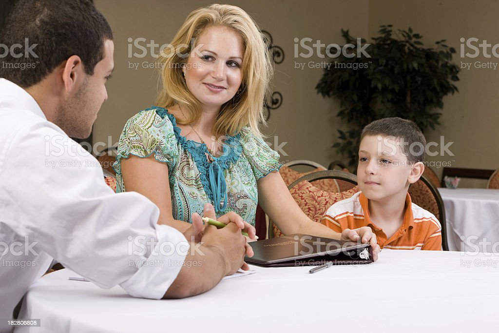 Financial Planner Discusses College With Mom and Child royalty-free stock photo