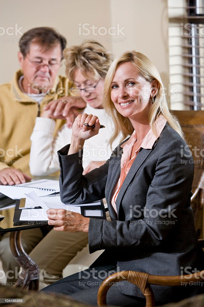 Financial planner or consultant helping senior couple royalty-free stock photo
