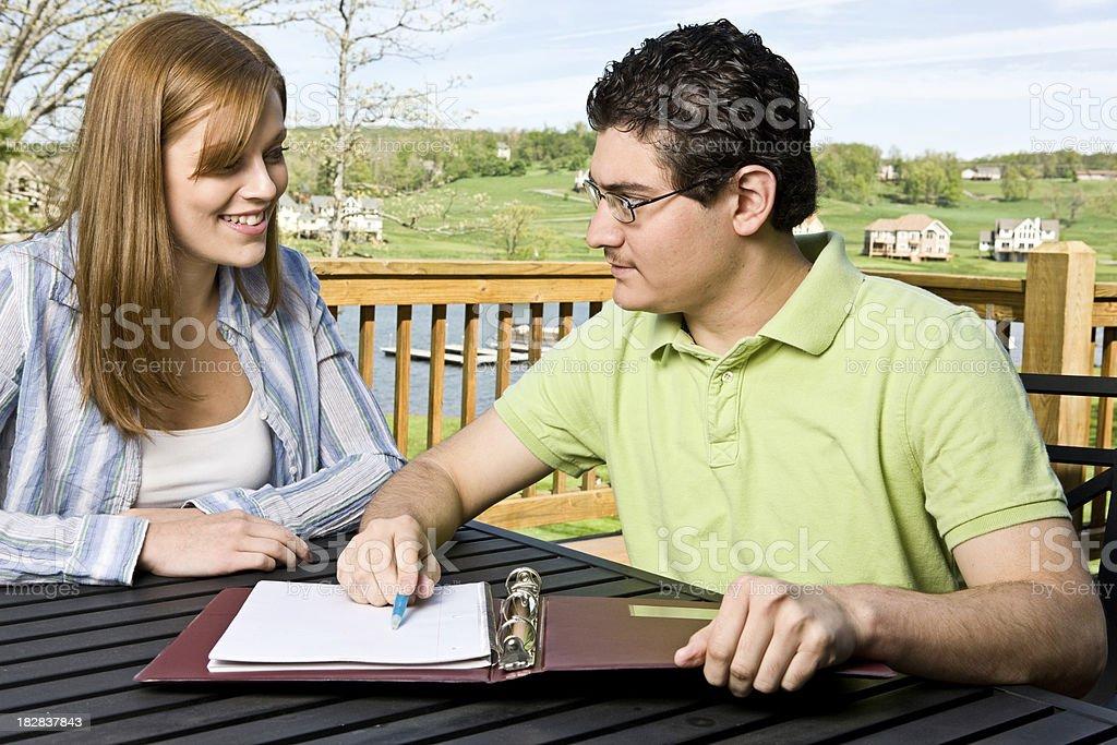 Financial Planner Reviews Long Term Plan royalty-free stock photo