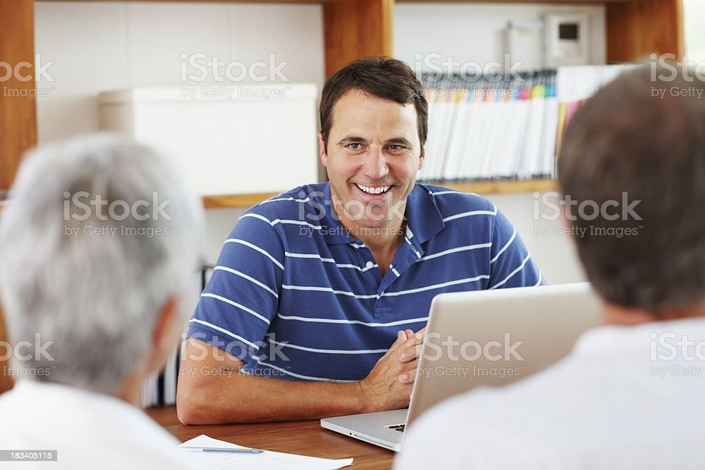 Financial planner with clients royalty-free stock photo