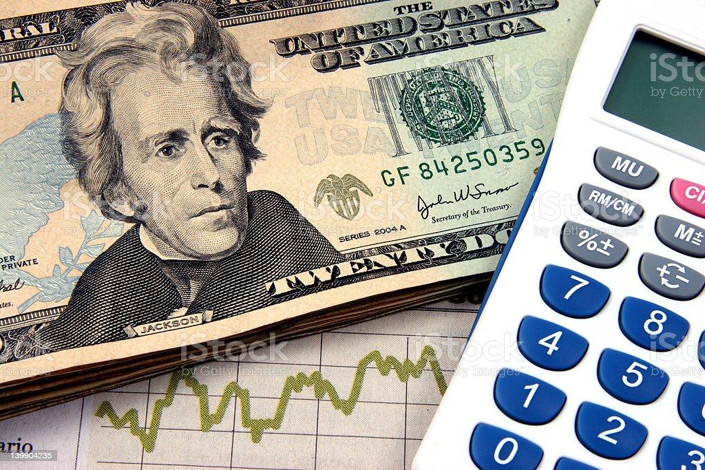 Financial planning calculator twenties stock photo