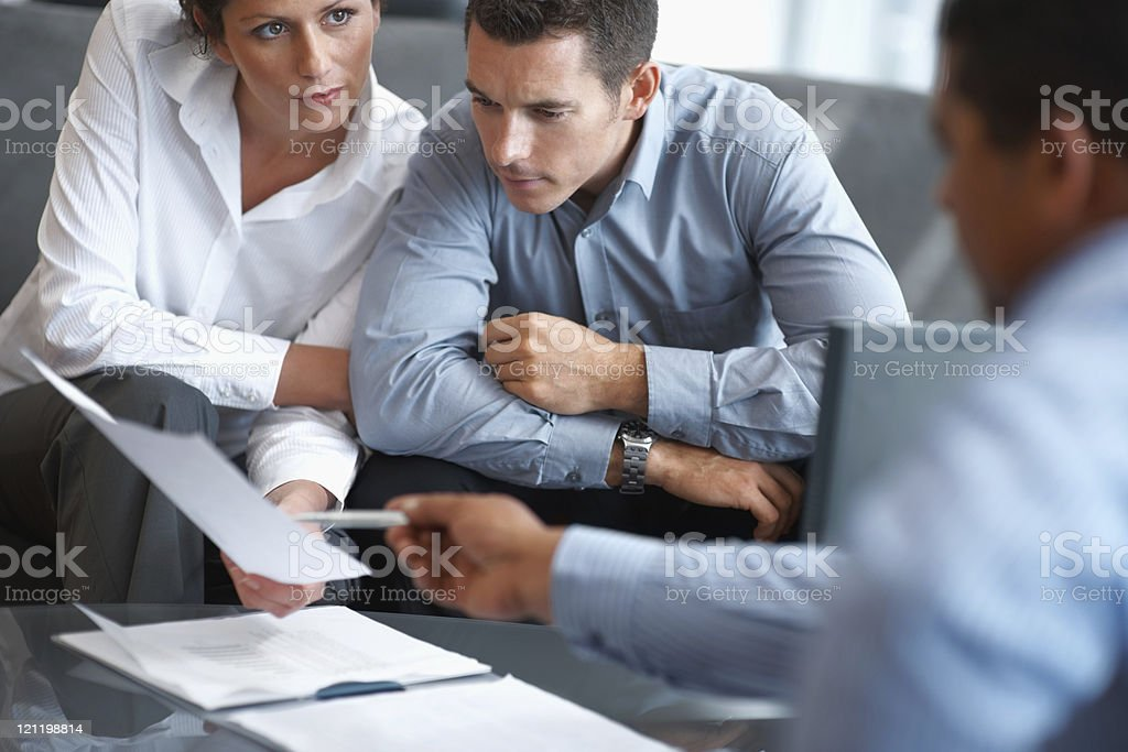 Financial Planning - Couple getting consulted royalty-free stock photo