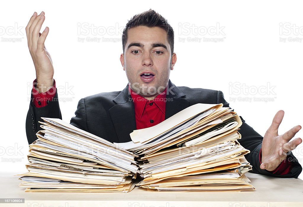 Financial Problems, Young Man with Paperwork Overload and Unpaid Bills stock photo