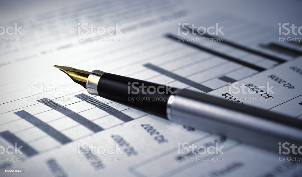 Financial report graph with pen stock photo
