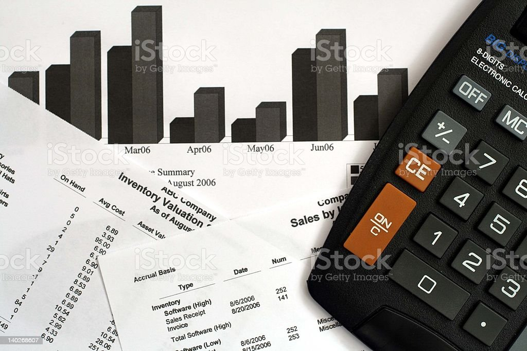 Financial Reports and Calculator royalty-free stock photo