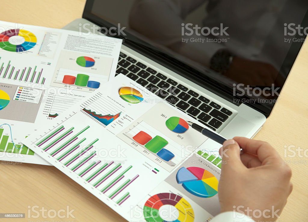 financial research with charts stock photo