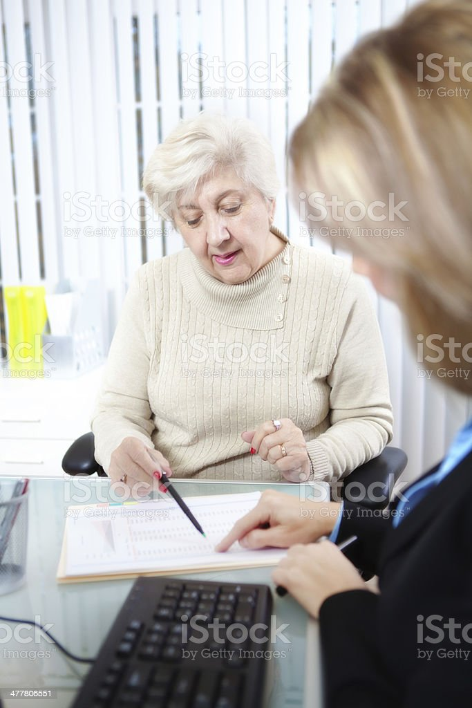 Financial Service Professional Woman Working with Senior Customer Vt royalty-free stock photo