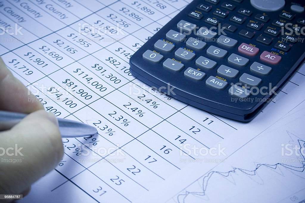 financial statement and calculator royalty-free stock photo